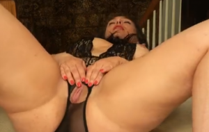 Big-assed dame strips and paws at her big pussy