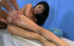 Nasty oil covered brunette gets her wet cunt drilled by masseur